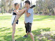 Sexy petite teen Carmen Callaway stretches outdoors and fucks her trainee