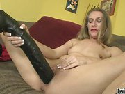 Sexy MILF fucks her dripping pussy with 2 huge black dildos!