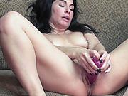 Mature slut Cleo Leroux stuff her twat with a dildo