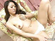 Naughty Ruri Hayami strips and toys her pretty pussy cumming hard in a chair.