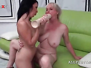 Dirty mature lesbian gets bald cunt nailed with huge dildo