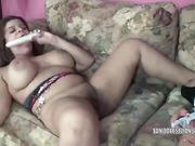 Busty lesbian babe Lavender Rayne shares her toys with curvy Latina MILF Angel Lynn